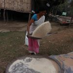 Local lady sifting grains